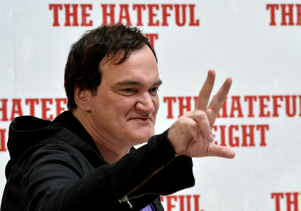 """US film director Quentin Tarantino poses during a photocall for his latest movie, """"The Hateful Eight"""" in Rome on January 28, 2016 (AFP Photo/Tiziana Fabi)"""