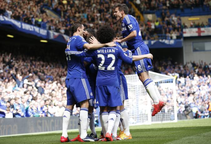 """Football - Chelsea v Crystal Palace - Barclays Premier League - Stamford Bridge - 3/5/15 Eden Hazard celebrates with team mates after scoring the first goal for Chelsea  Action Images via Reuters / Carl Recine Livepic EDITORIAL USE ONLY. No use with unauthorized audio, video, data, fixture lists, club/league logos or """"live"""" services. Online in-match use limited to 45 images, no video emulation. No use in betting, games or single club/league/player publications.  Please contact your account representative for further details."""