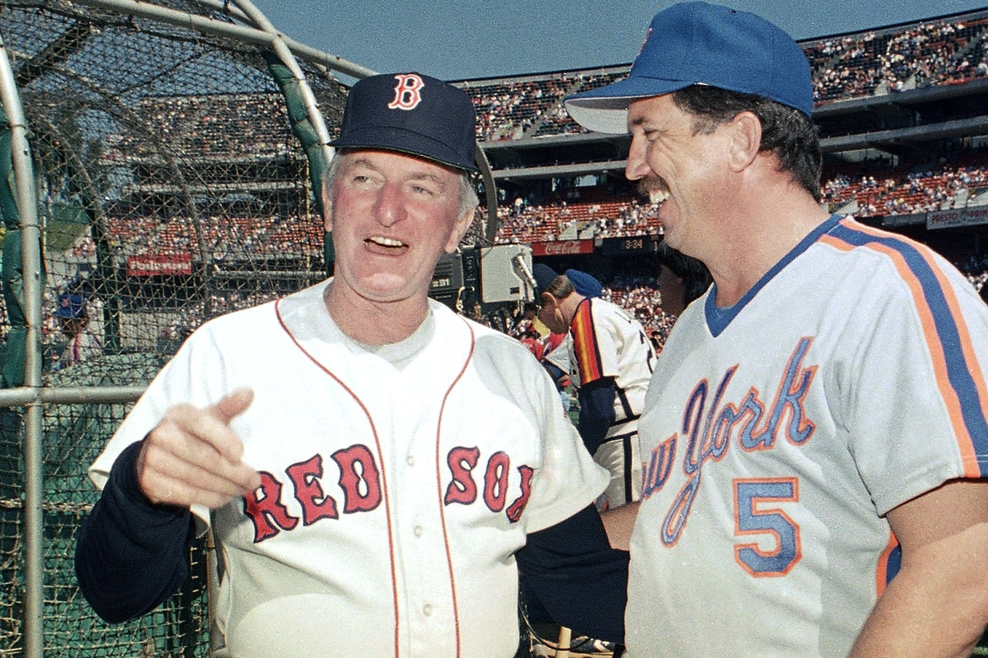 FILE - In this July 13, 1987, file photo, American League All-Star manager John McNamara, left, of the Boston Red Sox, chats with National League counterpart Davey Johnson, of the New York Mets, between workouts in preparation for the upcoming All-Star Game in in Oakland, Calif. McNamara, who managed several Major League Baseball teams during his career, died Tuesday, July 28, 2020, in Tennessee. He was 88. (AP Photo/Paul Sakuma, File)
