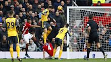Arsenal shocks Man United with Giroud's late equalizer to salvage draw