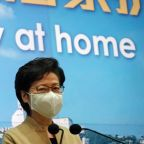 Stay at home, Hong Kong leader urges as COVID-19 surges anew