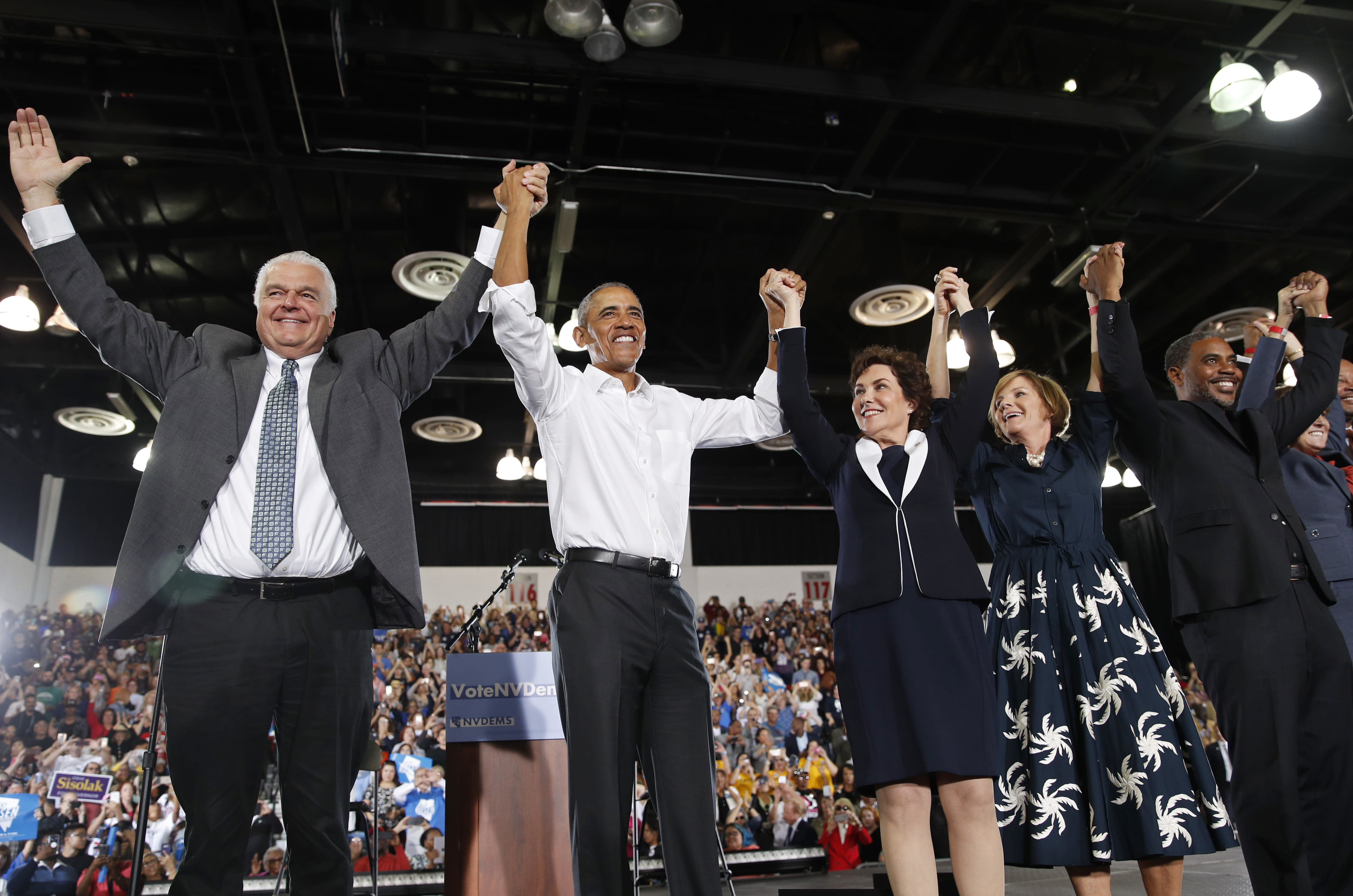 Former President Barack Obama, second from left, cheers at a rally in support of Clark County Commission Chair and Democratic gubernatorial candidate Steve Sisolak, left, candidate for Senate Jacky Rosen, third from left, Susie Lee, Democratic candidate for Nevada's third congressional district, second from right, Steven Horsford, candidate for Nevada's fourth congressional district, right, and other Nevada Democrats, Monday, Oct. 22, 2018, in Las Vegas. (AP Photo/John Locher)