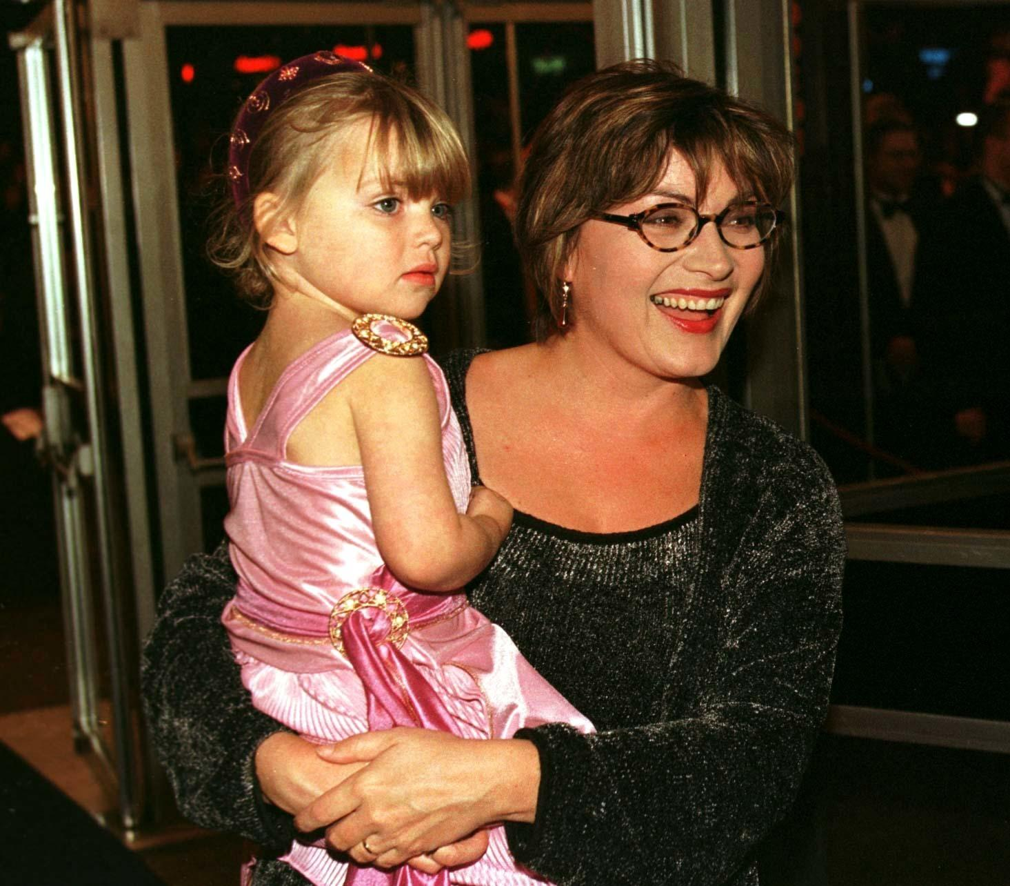 """PA NEWS PHOTO 9/10/97  TV Presenter Lorraine Kelly with her daughter attend the movie premiere of """"Hercules"""" at the Odeon, Leicester Square, London"""