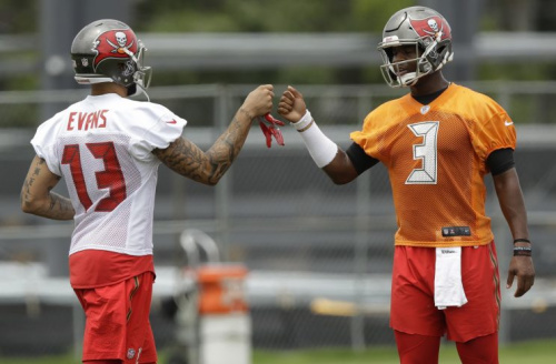 Jameis Winston and Mike Evans will try to lead the Buccaneers back to the playoffs. (AP)