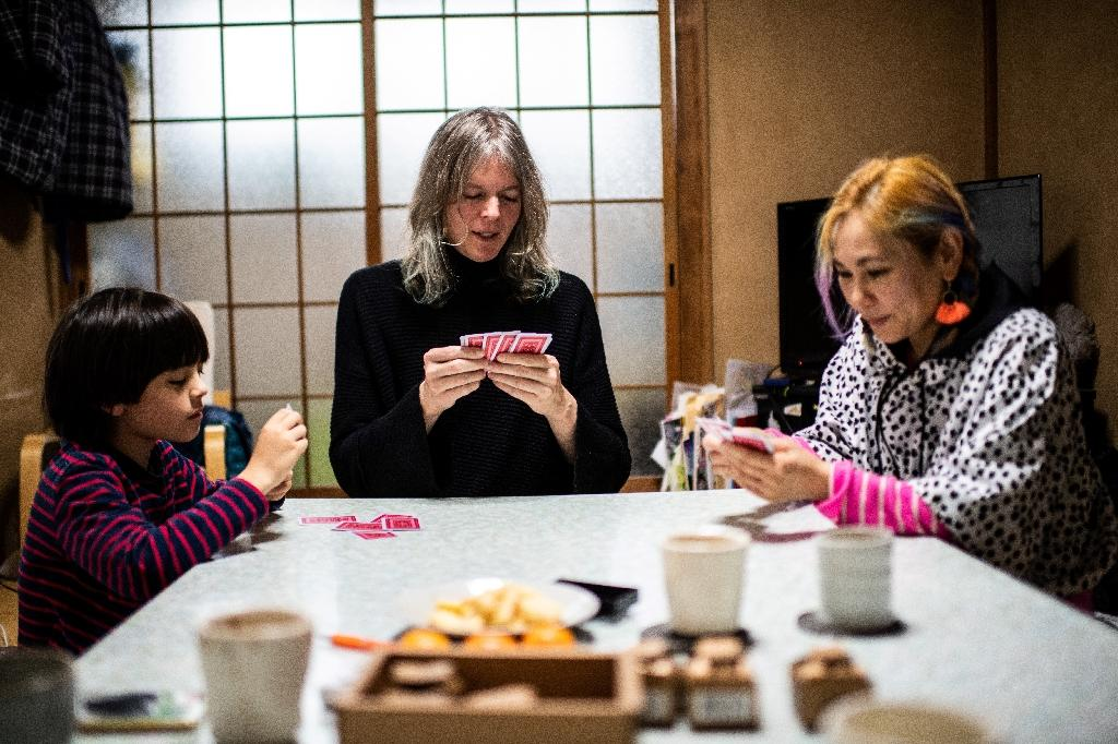Elin McCready, a 45-year-old American, who has three children with her Japanese wife Midori has hit a bureaucratic brick wall after registering her new gender in Tokyo (AFP Photo/Martin BUREAU)