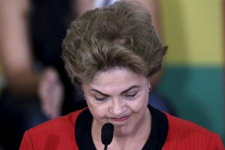 Brazil's President Dilma Rousseff reacts during a conference with representatives from workers' unions and social movements, in Brasilia