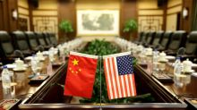 China leaves door open for trade war talks but not with American 'knife at its neck'