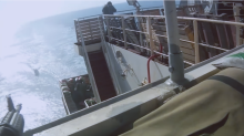 Gun battle at sea captured in viral video