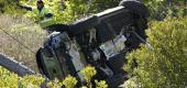 Workers move a vehicle on its side after a rollover accident involving golfer Tiger Woods. (AP)