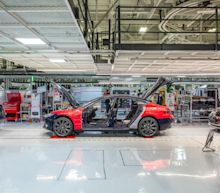 Tesla holds on to recent gains with bullish analyst target of $2,300