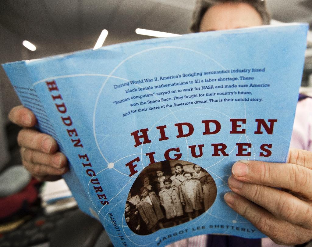 The trio's work was largely forgotten until they were profiled in the book 'Hidden Figures' decades later by author Margot Lee Shetterly (AFP Photo/PAUL J. RICHARDS)