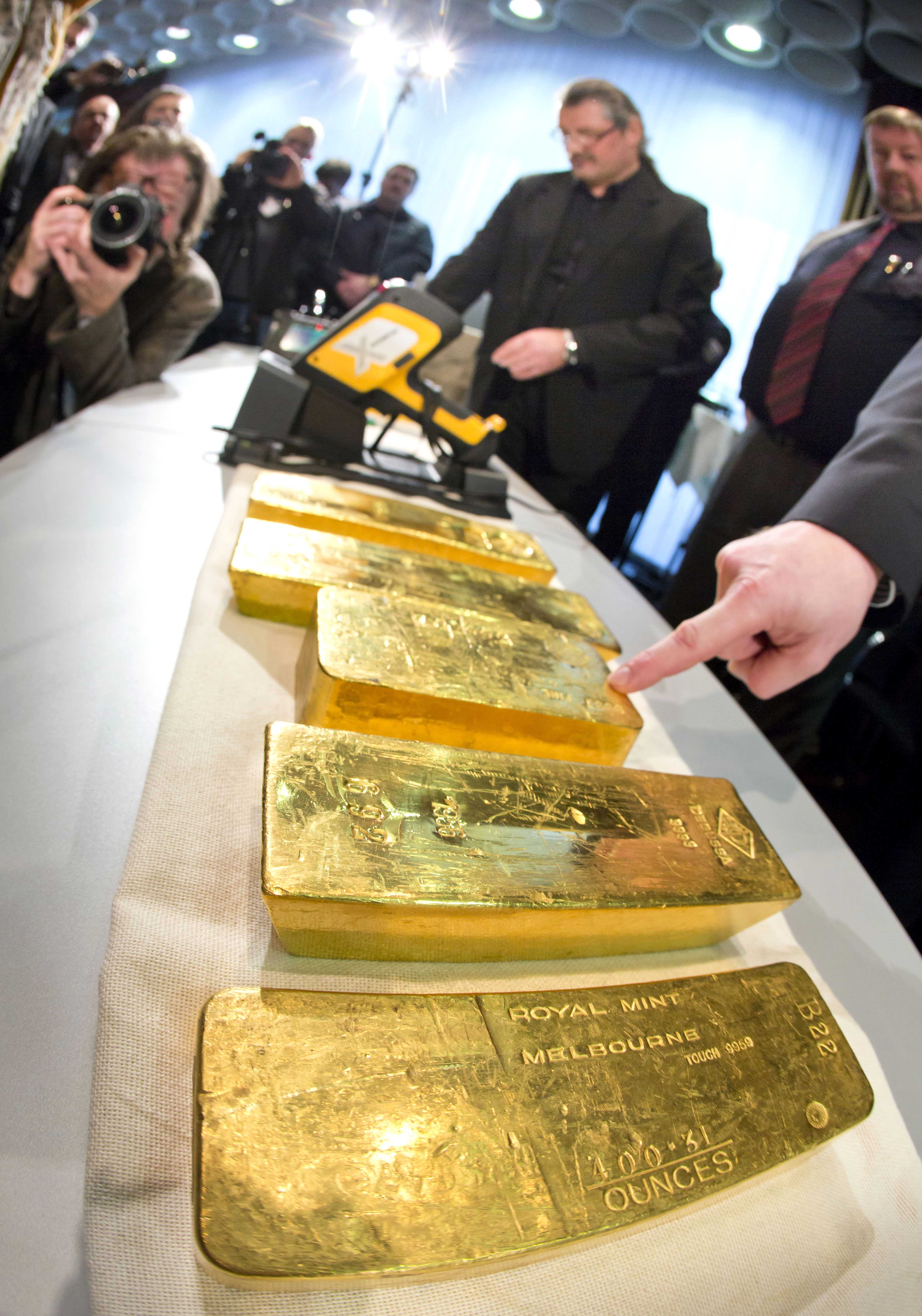 Gold ingots are on display during a press conference of Germany's Central Bank at their headquarters in Frankfurt, Wednesday Jan. 16, 2013. Germany's central bank is to bring back home some US $36 billion ( 27 billion euro) worth of gold stored in the United States and France. The Bundesbank said in a statement Wednesday that it will repatriate all 374 tons of gold it had stored in Paris by 2020. An additional 300 tons - equivalent to 8 percent of the Bundesbank's total reserves worth about US $183 billion will also be shipped from New York to Frankfurt. Frankfurt will hold half of Germany's 3,400 tons of gold by 2020, with New York retaining 37 percent and London storing 13 percent. The move follows criticism from Germany's independent Federal Auditors' Office last year bemoaning the central bank's oversight of gold reserves abroad.(AP Photo/ dpa/ Frank Rumpenhorst)