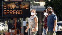2nd US virus surge hits plateau, but few experts celebrate