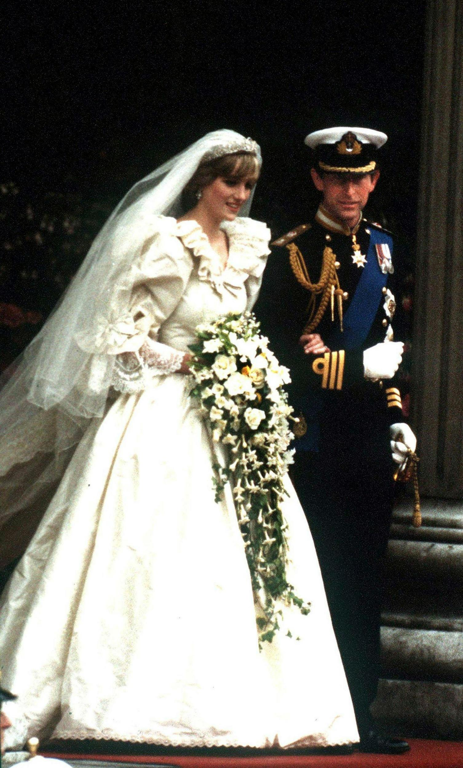(FILE PHOTO) The Prince and Princess of Wales leave St Paul's Cathedral after their wedding, 29th July 1981. She wears a wedding dress by David and Elizabeth Emmanuel and the Spencer family tiara.