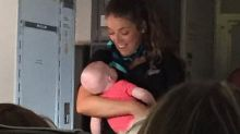 Flight attendant helps mother soothe baby midflight after 'all hell broke loose'