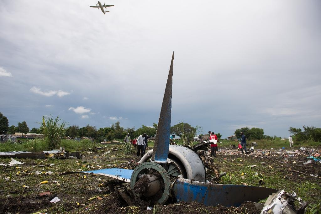 Dozens of passengers were illegally on board the An-12 cargo plane, which crashed into a farming community on an island in the White Nile river seconds after departure