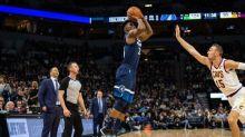 NBA roundup: Butler jeered, cheered in Wolves win