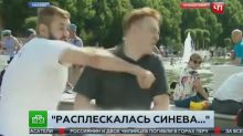 Russian Reporter Punched on Live TV