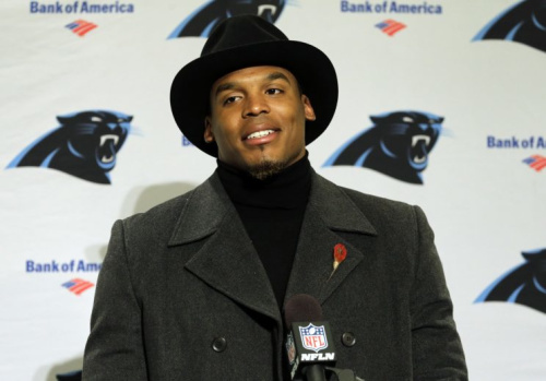 Cam Newton didn't start on Sunday because of a dress-code violation. (AP)