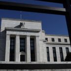 Fed sees no rate hikes in 2019, sets end to asset runoff
