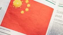 China demands an apology from a newspaper for a satirical cartoon of a Chinese flag with coronavirus particles