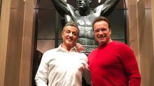 Sylvester Stallone and Arnold Schwarzenegger pump up Christmas