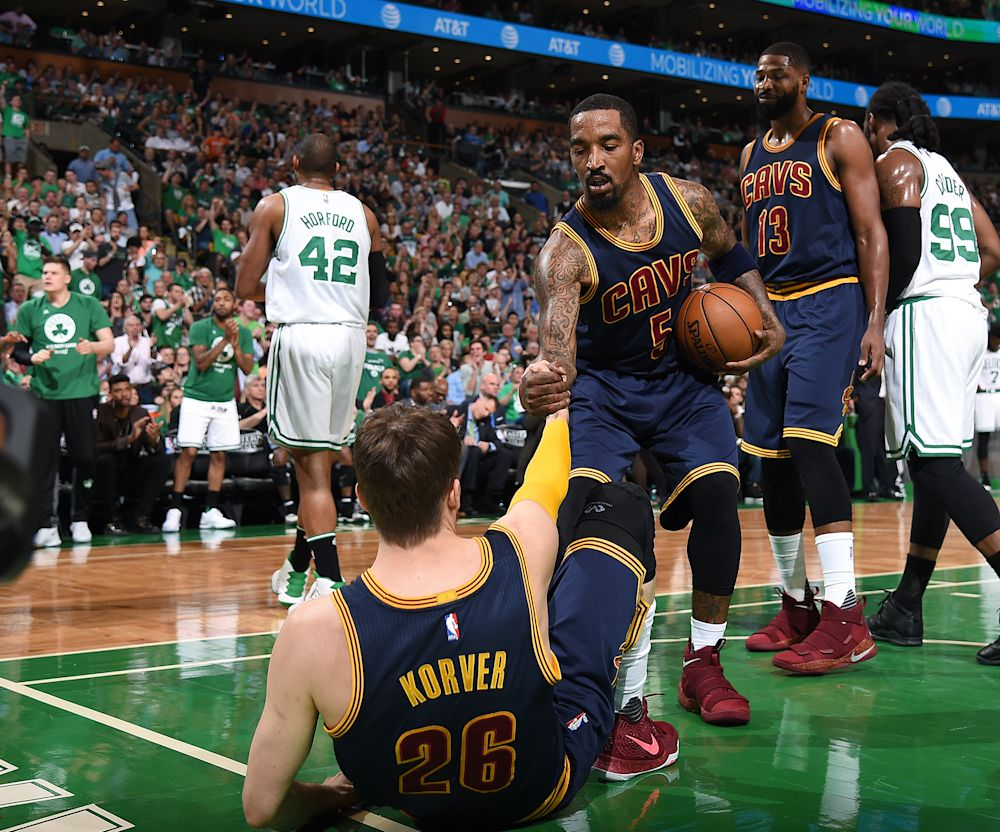 J.R. Smith helps Kyle Korver off the floor. (Getty Images)