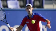 Novak Djokovic cruises in Olympic opener, questions match scheduling decisions