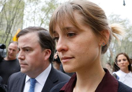 Actor Allison Mack, known for her role in the TV series 'Smallville', exits with her lawyer following a hearing on charges of sex trafficking in relation to the Albany-based organization Nxivm at United States Federal Courthouse in Brooklyn, New York, U.S., May 4, 2018. REUTERS/Brendan McDermid