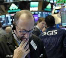 US stocks indexes close mostly higher after Fed rate hike