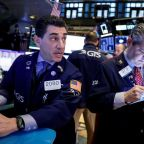 Stocks tumble, oil falls, gold spikes as virus fears grip markets