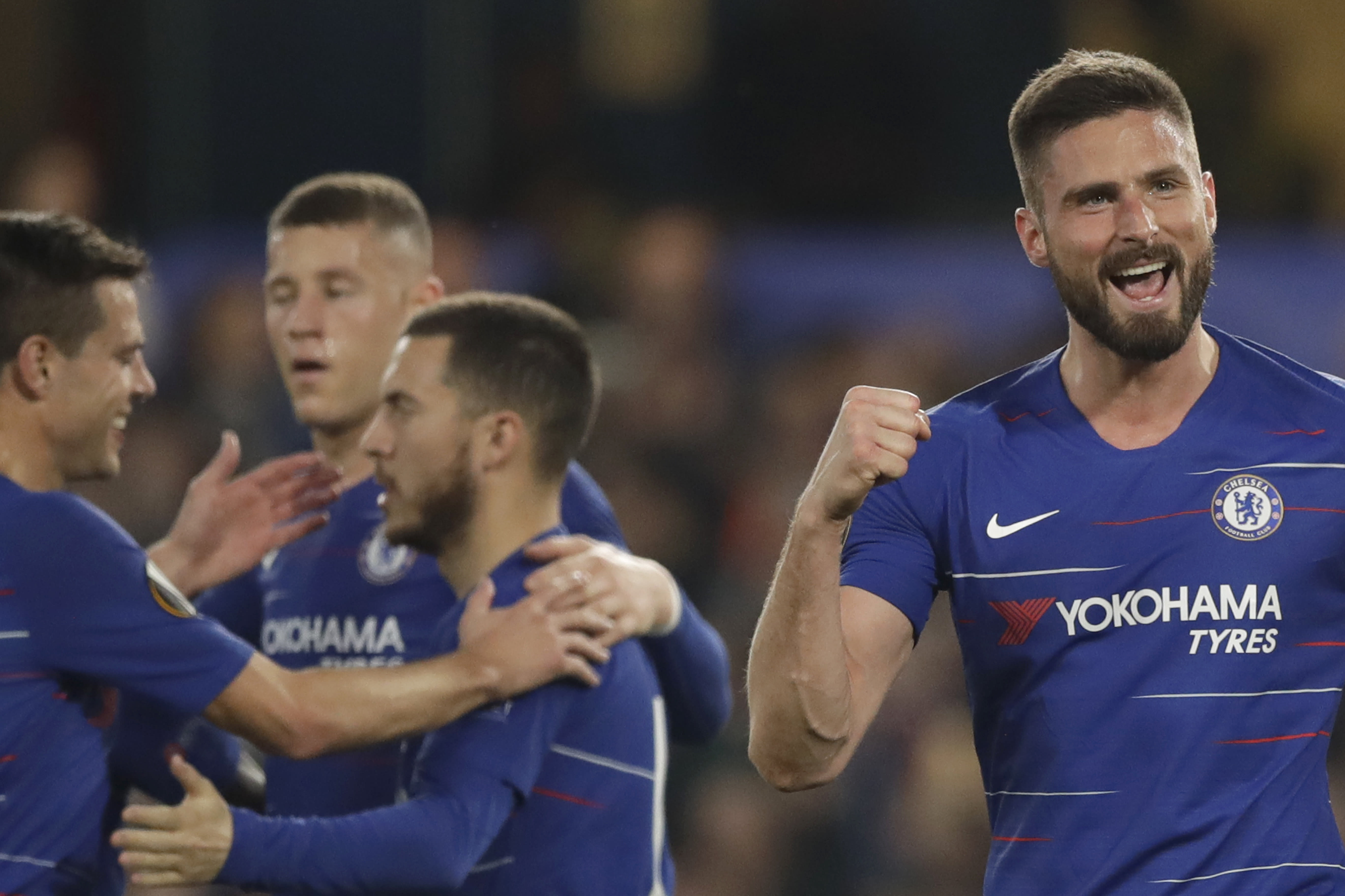 Chelsea's Olivier Giroud, the Europa League's top scorer, right, celebrates scoring his side's third goal during the Europa League quarterfinal, second leg, soccer match between Chelsea and Slavia Prague at Stamford Bridge stadium in London, Thursday, April 18, 2019. (AP Photo/Matt Dunham)