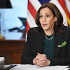 A nurse who sent her jailed husband videos threatening to kill Kamala Harris was charged after the Secret Service intercepted them