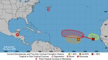 Three waves are headed west in the Atlantic. Two could merge into tropical depression