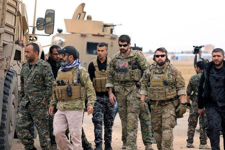 FILE PHOTO: Syrian Democratic Forces and U.S. troops are seen during a patrol near Turkish border in Hasakah, Syria November 4, 2018. REUTERS/Rodi Said