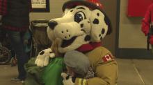 Firefighters bring Christmas spirit to underprivileged Calgary kids