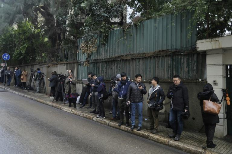 Journalists wait outside a Beirut house identified by court documents as belonging to Ghosn (AFP Photo/JOSEPH EID)