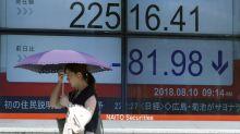 Asian shares slip despite upbeat Japanese economic data