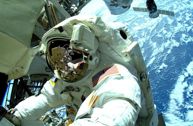 Spacewalk cancelled after water found in helmets again