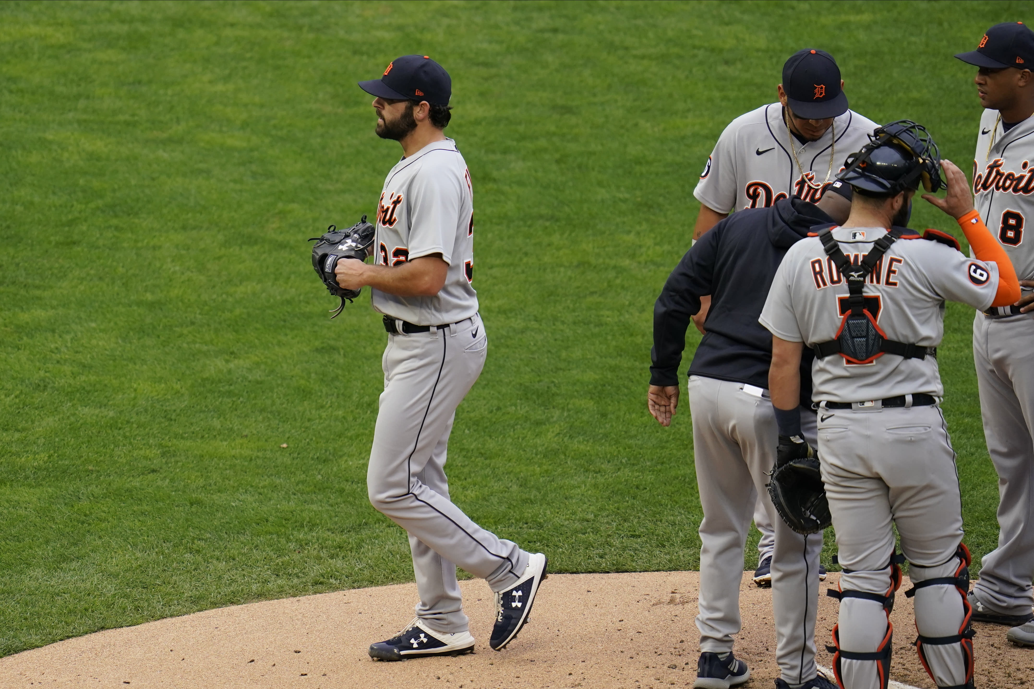 Detroit Tigers pitcher Michael Fulmer, left, leaves in the third inning after he was pulled in a baseball game against the Minnesota Twins, Monday, Sept. 7, 2020, in Minneapolis. (AP Photo/Jim Mone)
