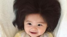 This 7-month-old is going to give you serious hair envy