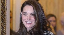 Heavily pregnant Kate glows as she greets fashion elite