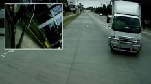 Shocking dashcam shows truck turning at intersection, flips car