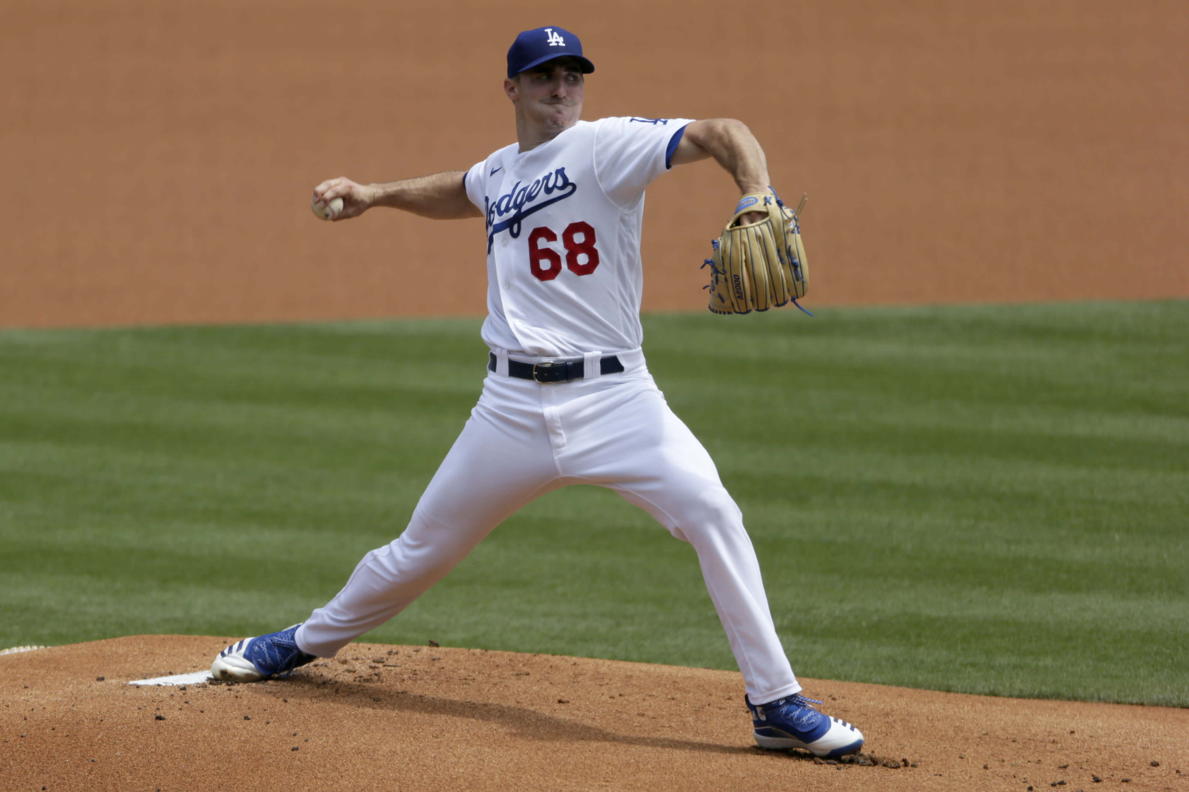 Los Angeles Dodgers starting pitcher Ross Stripling throws to the plate against the Colorado Rockies during the first inning of a baseball game in Los Angeles, Sunday, Aug. 23, 2020. (AP Photo/Alex Gallardo)
