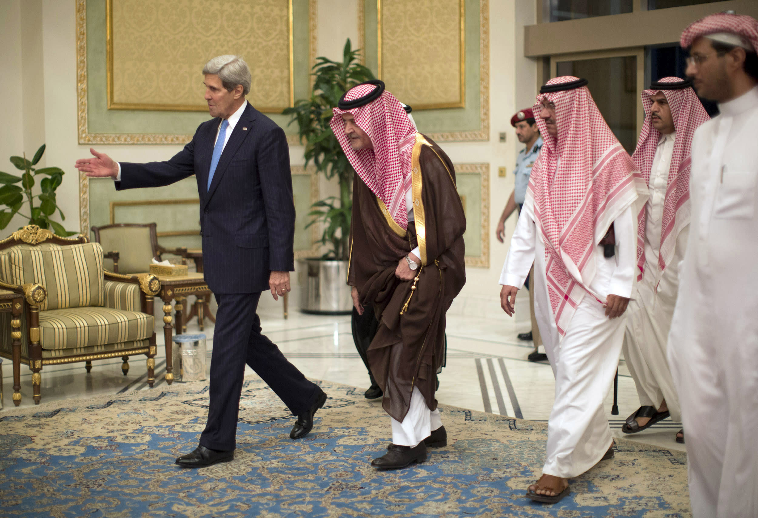 """FILE-In this Sunday, Nov. 3, 2013 file photo, U.S. Secretary of State John Kerry, left, is greeted by Saudi Foreign Minister Prince Saud Al-Faisal bin Abdulaziz al-Saud, after Kerry arrived in Riyadh, Saudi Arabia. In an unexpected consequence of the global diplomacy over Iran, Israel and Gulf Arab states led by Saudi Arabia are boosting back-channel contacts and finding increasing common ground over their mutual dismay with Tehran's drive to mend ties with the West and reach a nuclear deal. The """"strange alliance"""" _ in the word of one former diplomat _ highlights how the ripples from Iran are driving some allies apart while pushing foes closer. It also highlights the Sunni world's distress at the possibility of a bomb in the hands of a Shiite power. (AP Photo/Jason Reed, Pool, File)"""