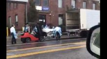 Shocking video shows the bodies of NYC coronavirus victims being forklifted into a refrigerated truck used as a temporary morgue