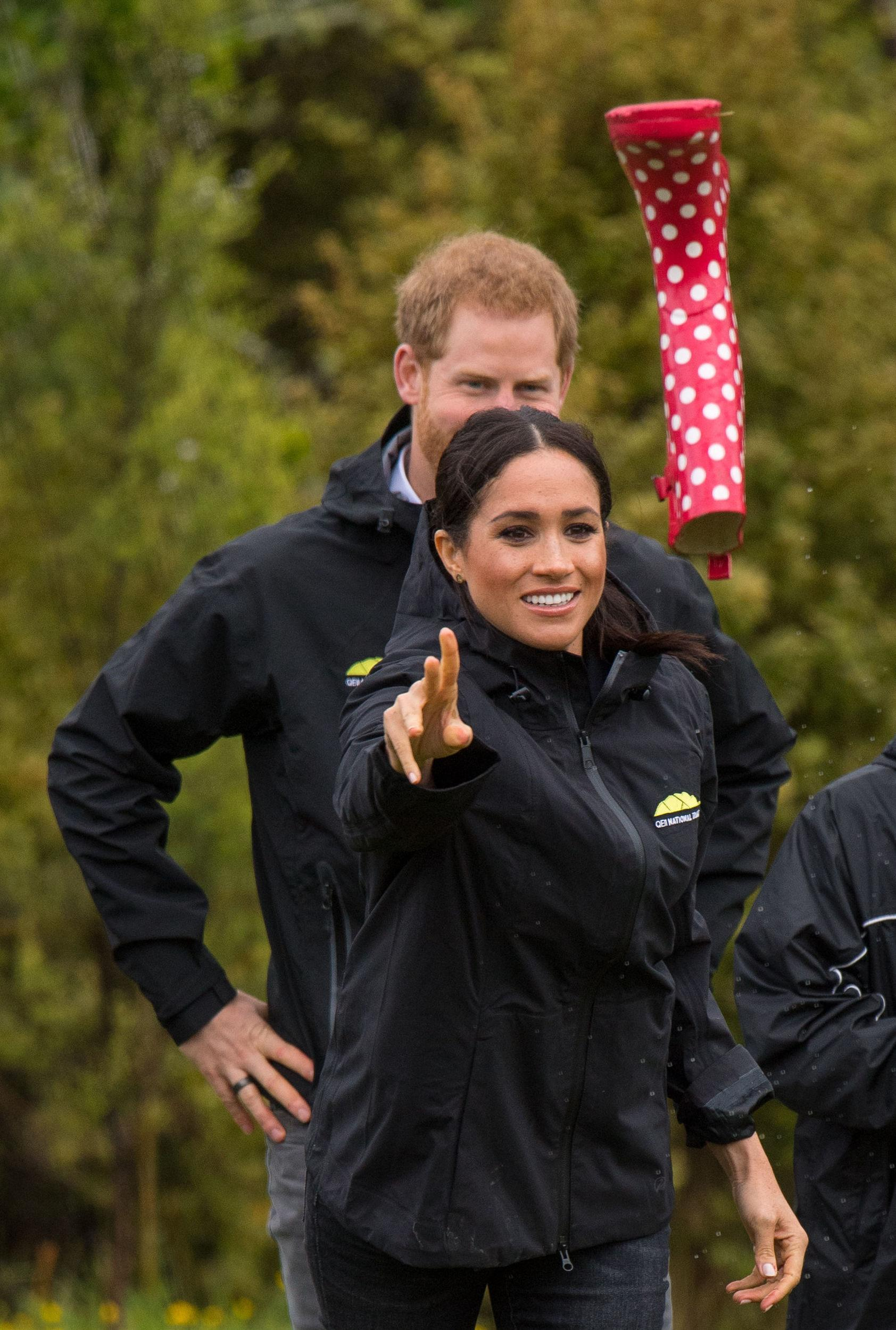 The Duchess of Sussex takes part in a welly wanging contest following a dedication of an area of bush to the Queen's Commonwealth Canopy, in Redvale on the North Shore, on day three of the royal couple's tour of New Zealand.
