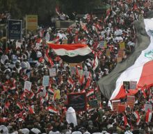 Iraqis mass to urge US troop ouster, rival rallies turn deadly