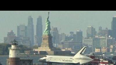 Shuttle floats into history