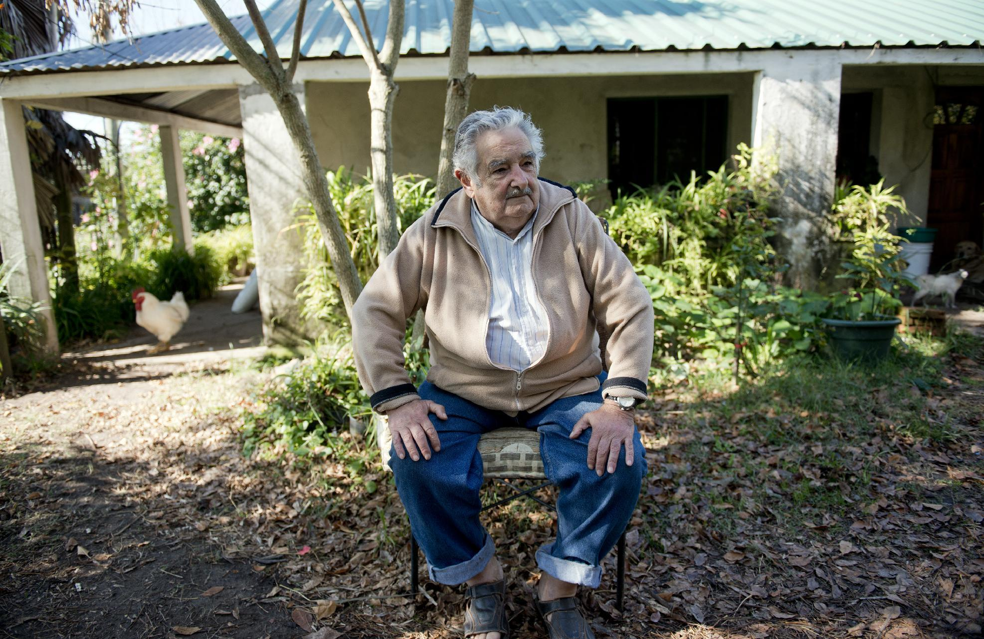 """Uruguay's President Jose Mujica sits outside his home during an interview on the outskirts of Montevideo, Uruguay, Friday, May 2, 2014. Mujica said Friday that his country's legal marijuana market will be much better than Colorado's, where he says the rules are based on """"fiction"""" and """"hypocrisy"""" because the state loses track of the drug once it's sold and many people fake illnesses to get prescription weed. Mujica says this won't be allowed in Uruguay, where the licensed and regulated market will be much less permissive with drug users. (AP Photo/Matilde Campodonico)"""